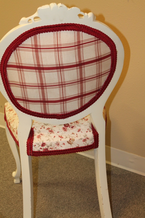 red chair reupholstered back side